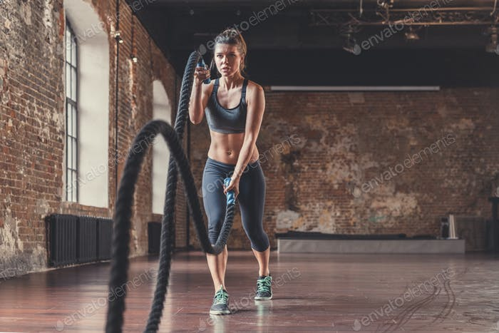 Athletic young girl with a rope