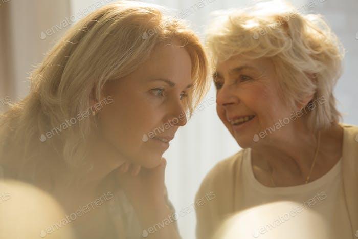 Senior woman talking with daughter
