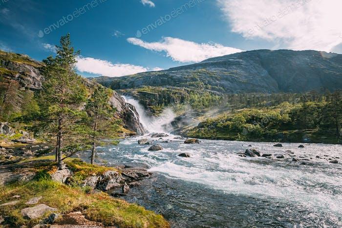 Kinsarvik, Hordaland, Norway. Waterfall Nykkjesoyfossen In Hardangervidda Mountain Plateau. Summer