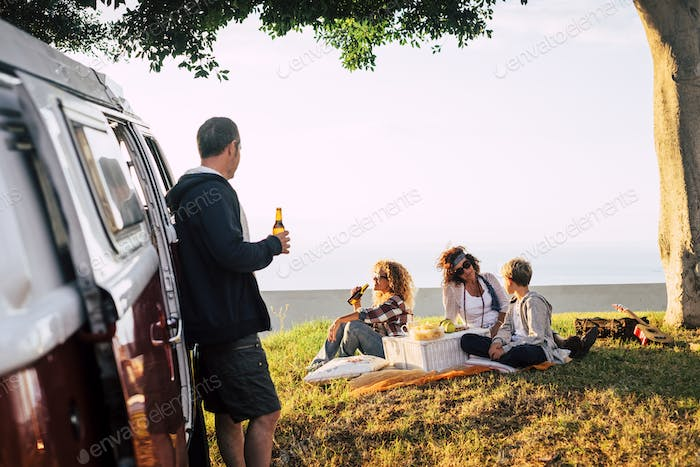 Group of mixed ages friends enjoying together the outdoor leisure activity in pic nic time