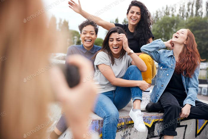 Group Of Female Friends Posing For Selfie On Mobile Phone In Urban Skate Park