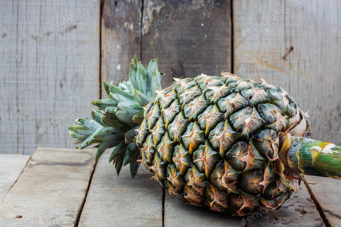 Pineapple on wooden floor