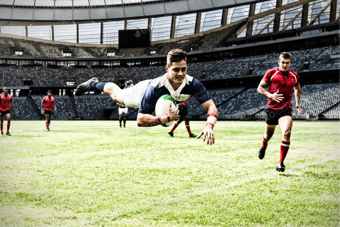 Digital composite image of rugby player jumping with the ball in sports stadium