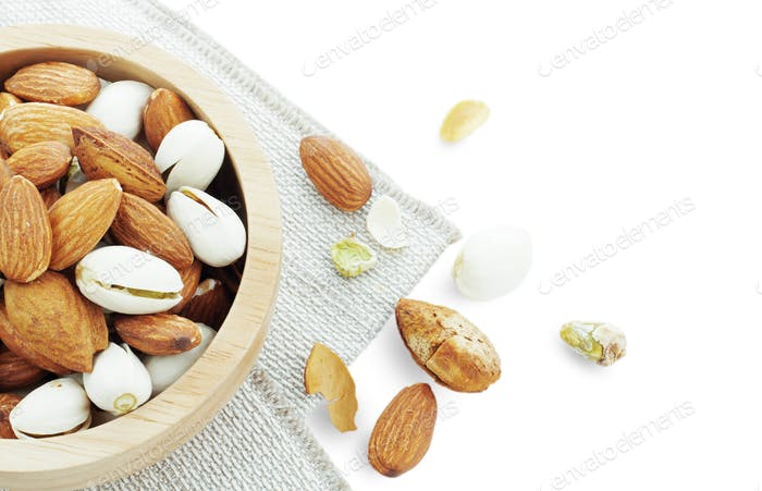 Many almonds on white background