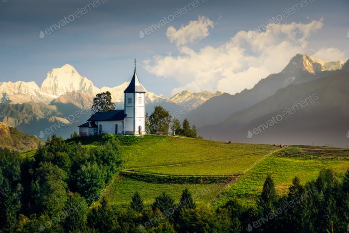 Landscape view of Jamnik church and generic mountains - composite image, Slovenia