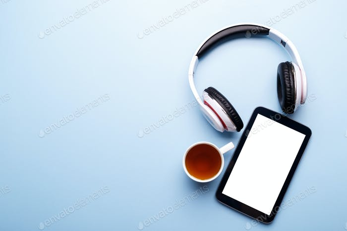 Tablet, head phones and cup of tea