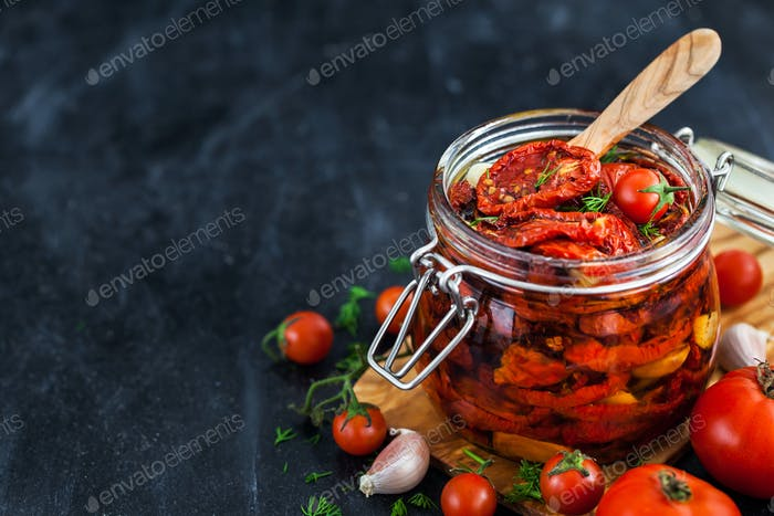 Sun dried tomatoes with garlic and olive oil in a jar