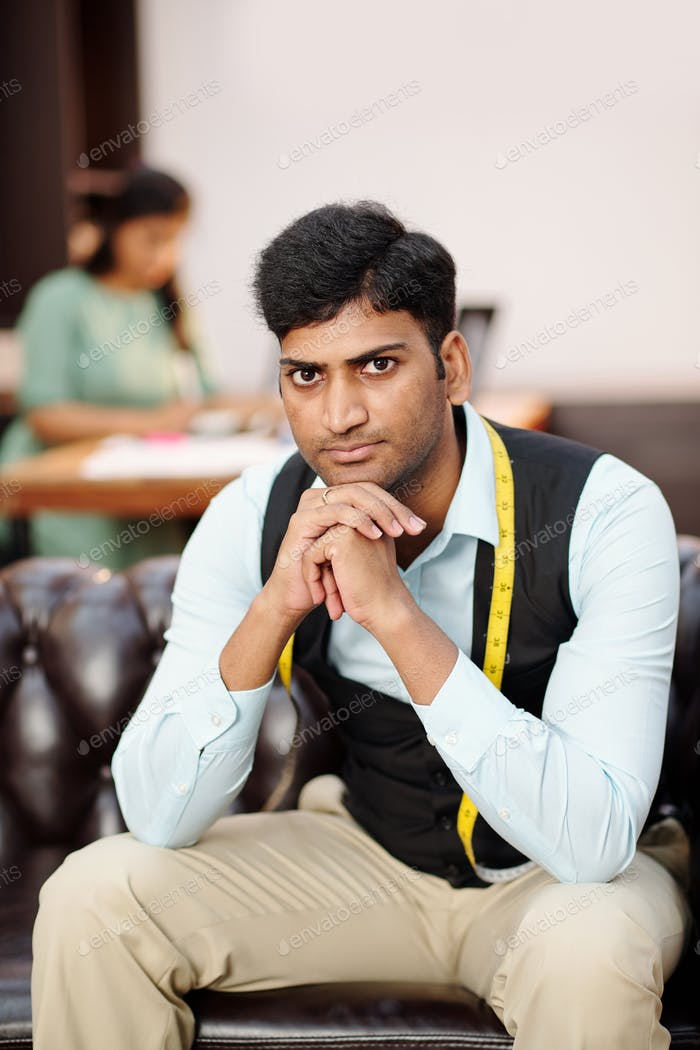 Young serious Indian tailor