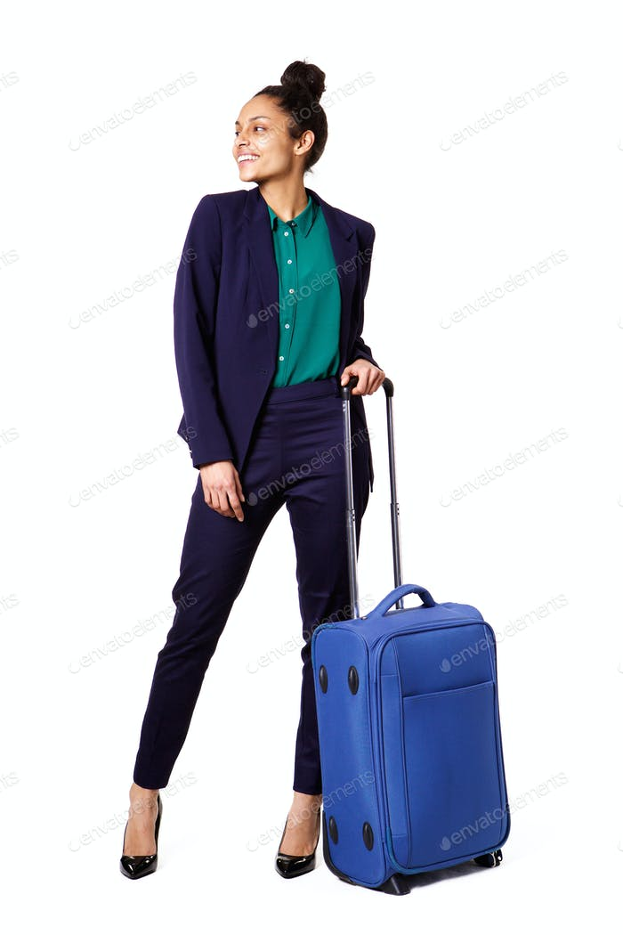 Business woman standing with bag looking away