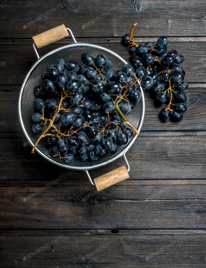 Black grapes in a saucepan.