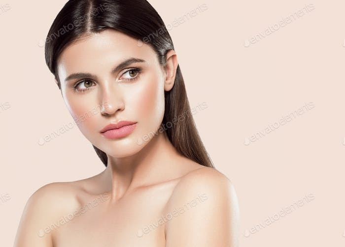 Beauty skin woman face beautiful model close up face natural makeup brunette hair. Color background.