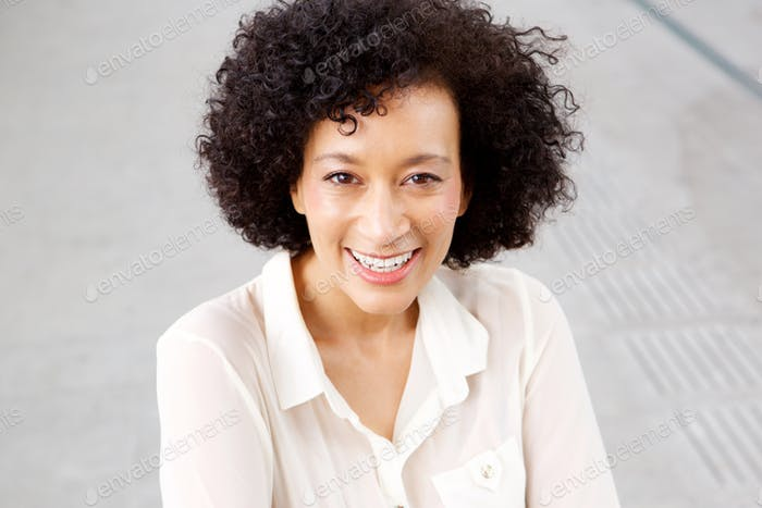 Close up smiling middle age woman with curly hair