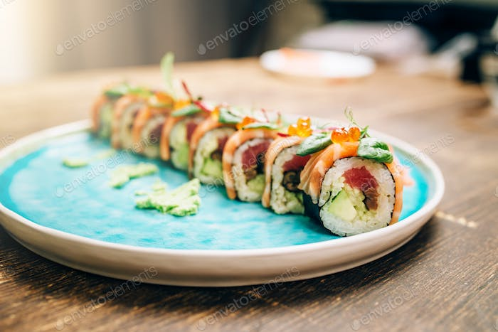 Sushi rolls with salmon fish on plate closeup
