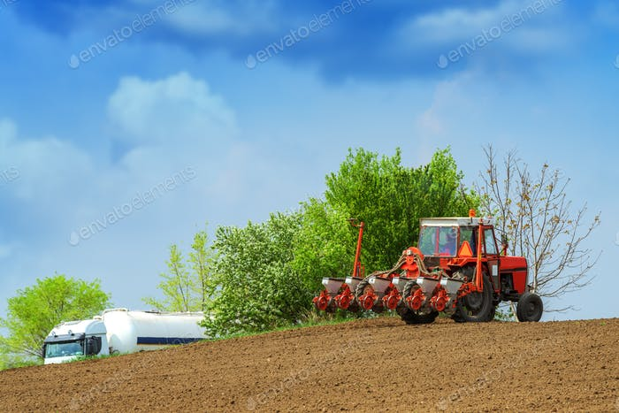 Tractor with mounted crop seeder