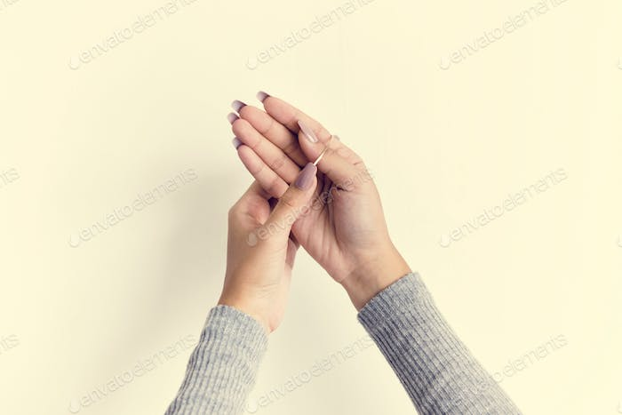 Closeup of woman hands with long sleeve isolated on white