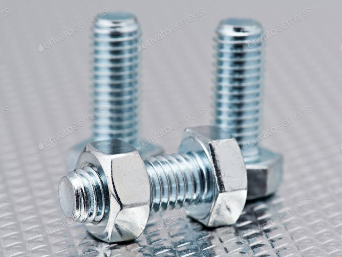 nuts and bolts bright group, randomly arranged bright metal background