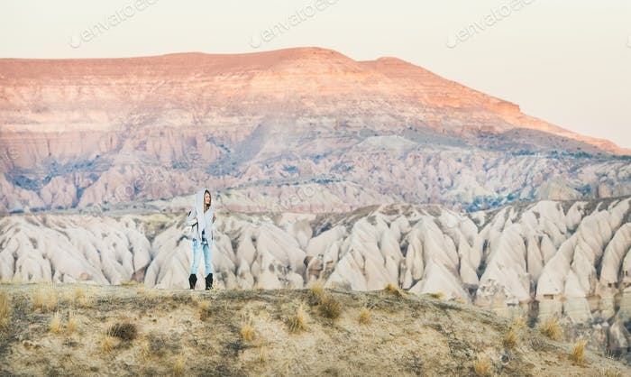 Young woman traveller hiking in mountains in Cappadocia, Central Turkey
