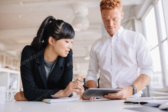 Business people working together on digital tablet