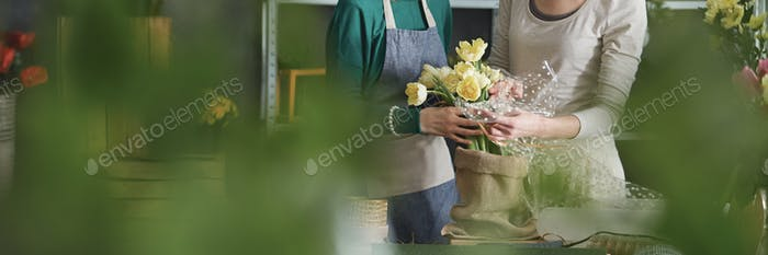 Florists arranging flowers