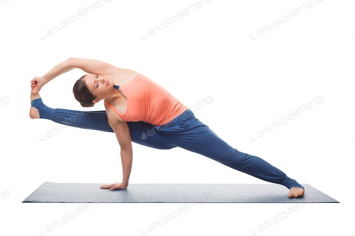 Beautiful sporty fit yogi girl practices yoga asana visvamitrasa