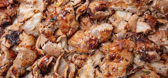 Shawarma, gyros background. Traditional turkish, greek meat food, closeup view