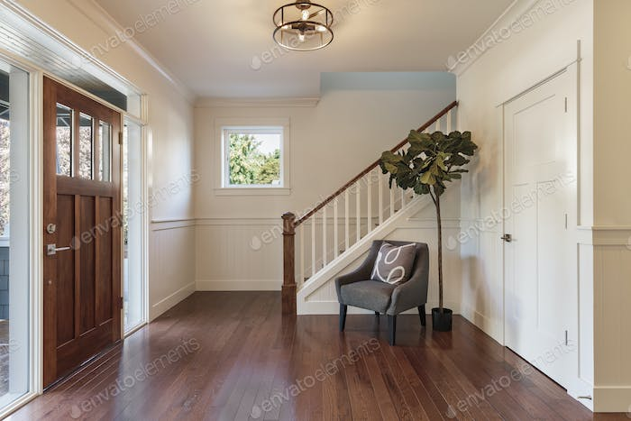 Armchair and tree in house entryway