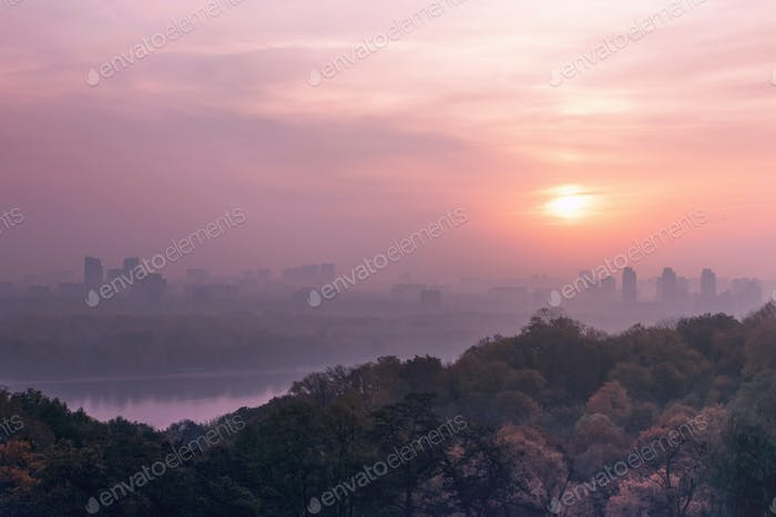 Pink Early morning, fog in the city. Pink dawn over the river in the metropolis. Cityscape Kiev