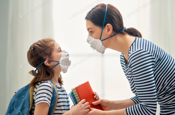 Mother and child wearing facemasks