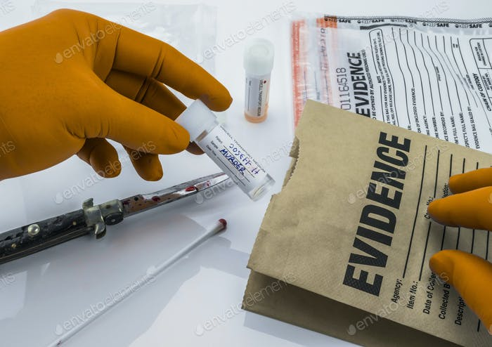 Crime scene for cutting weapon, Judicial police takes blood samples in evidence bag
