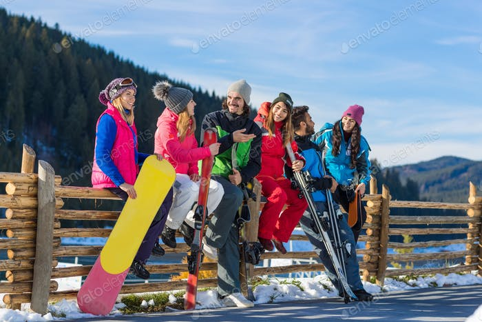 People Group With Snowboard Ski Resort Snow Winter Mountain Cheerful Friends Sitting On Wooden Hence