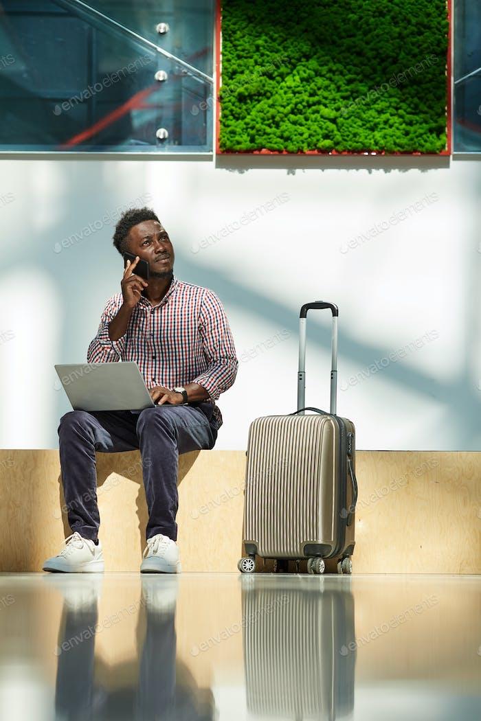 Businessman ordering plane tickets
