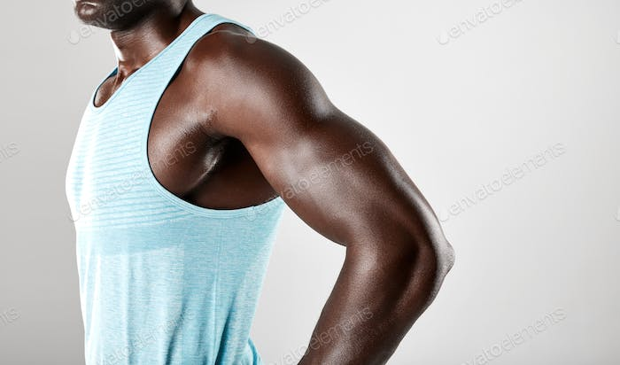 Young african man muscular arms