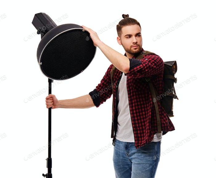 Director de iluminación aislado sobre fondo blanco.