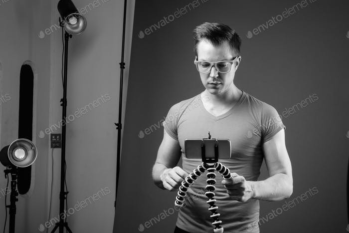 Young handsome man with eyeglasses in black and white