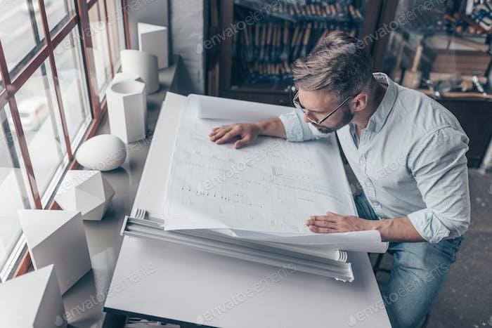 Mature architect at the desk