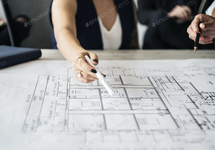Woman pointing at building plan