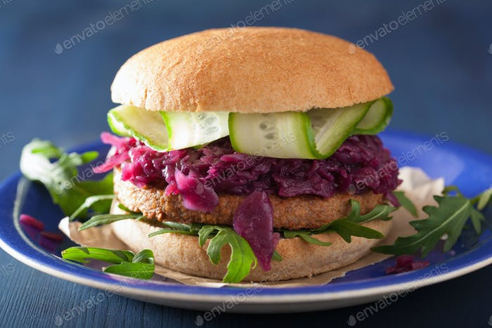 veggie soy burger with pickled red cabbage cucumber arugula