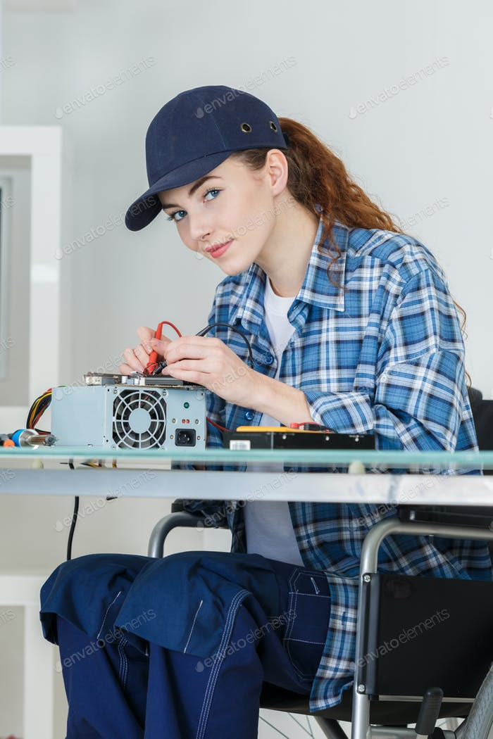 female pc technician fixing a pc