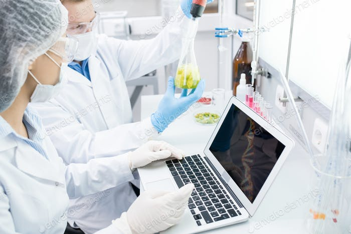 Bio Scientists Using Laptop  in Laboratory