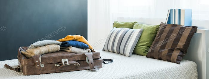 Traveler bedroom with old suitcase