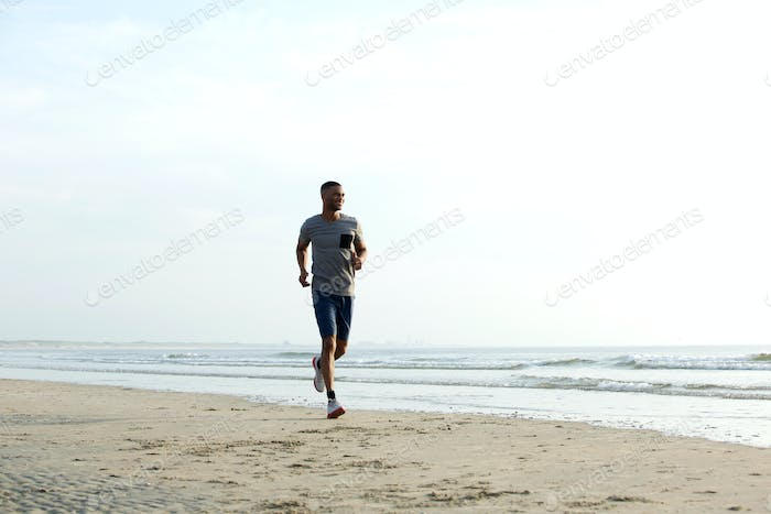 Fit african american man running