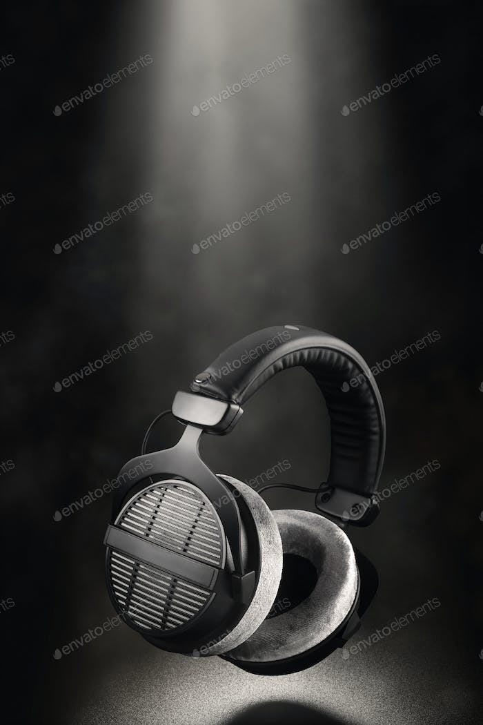 Professional studio headphones on black background.