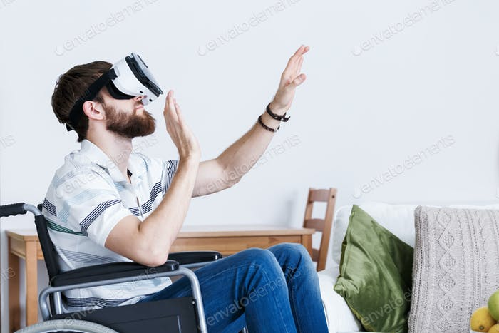Man on wheelchair in VR