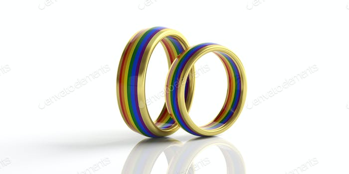 Pair of golden rainbow colors wedding rings isolated on white background, closeup view,