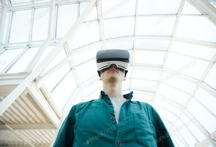 Futuristic Young Man in VR