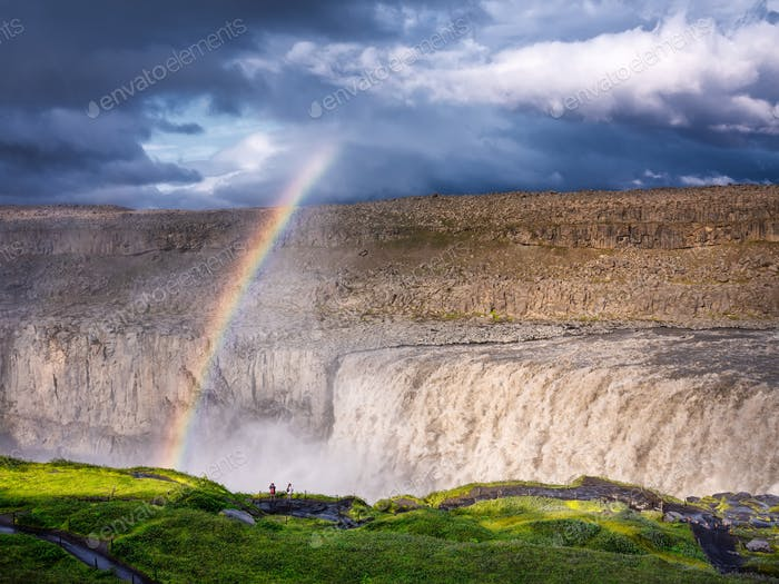 Dettifoss waterfall and rainbow, Iceland. Famous place in Iceland. A mountain valley and clouds.