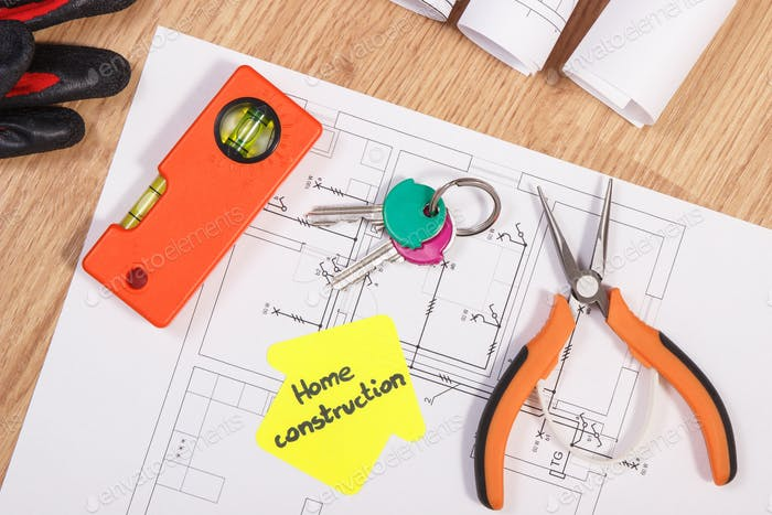 Home keys with electrical diagrams and accessories for engineering jobs, building home concept