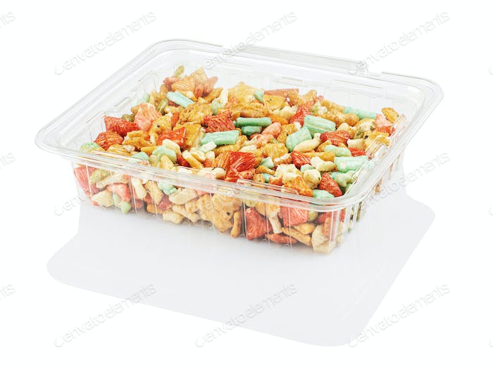 multicolored candy in a disposable plastic container isolated on awhite with clipping path