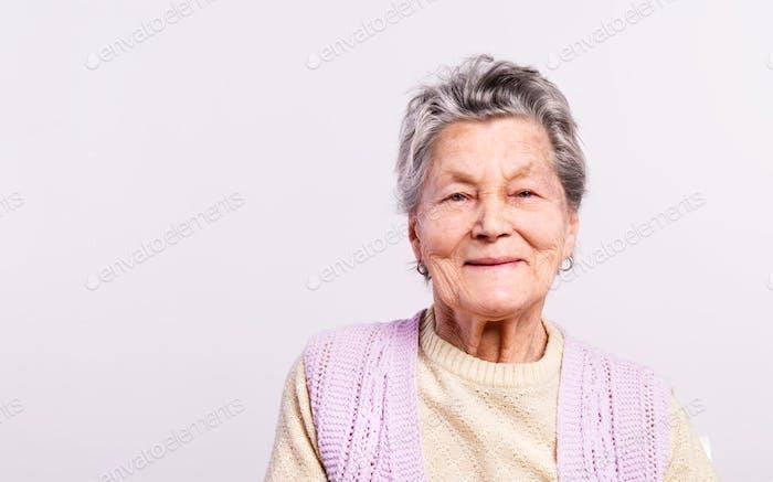Portrait of a senior woman in studio. Copy space.