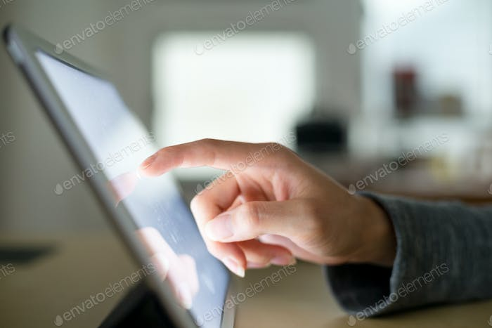 Woman touch on digital tablet